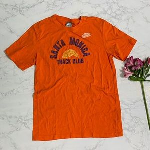 Nike Santa Monica track club orange tee m